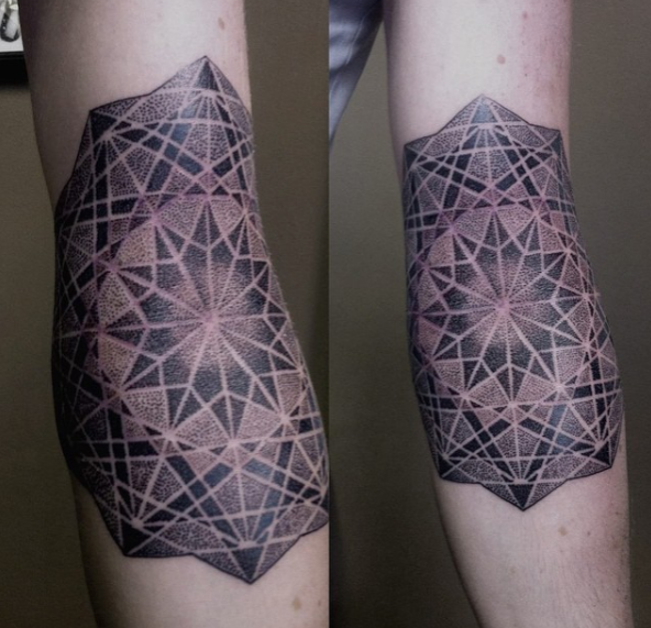 sacred geometry tattoo in black and grey by award winning artist