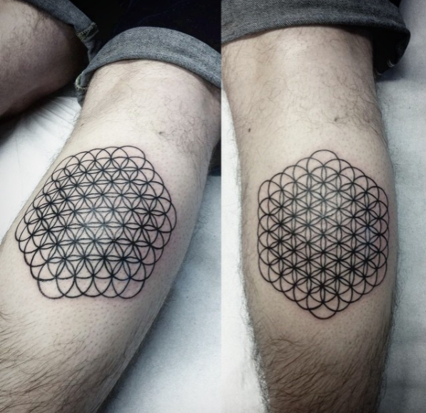 sacred geometry tattoo flower of life, black and grey symmetry pattern, minimalism, calf tattoo, pattern