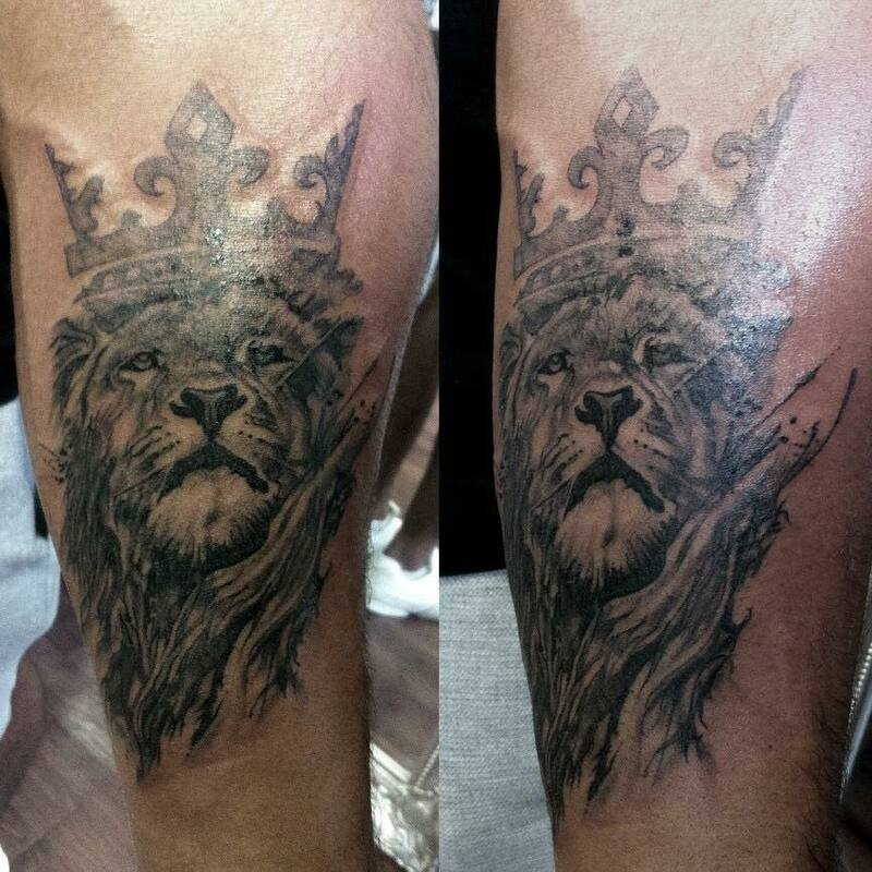 lion tattoo crown black and grey, realism of majestic lion animal king of the jungle, large tattoo